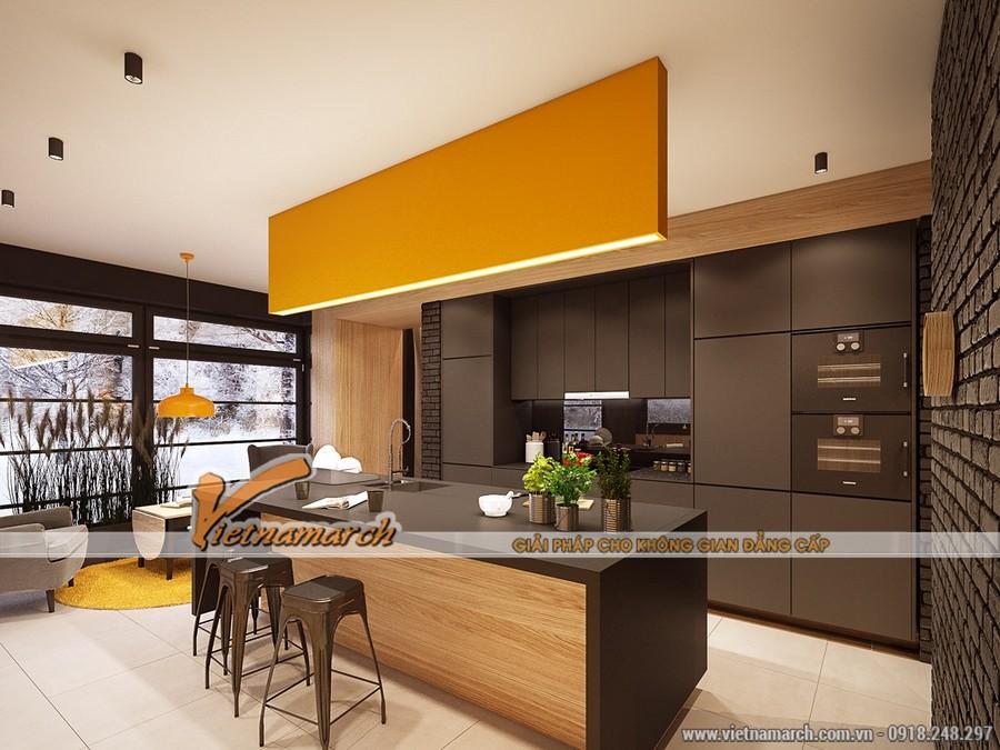 Không gian bếp hiện đại và ấm cúng với sự kết hợp các tông màu vàng, nâu, trắng