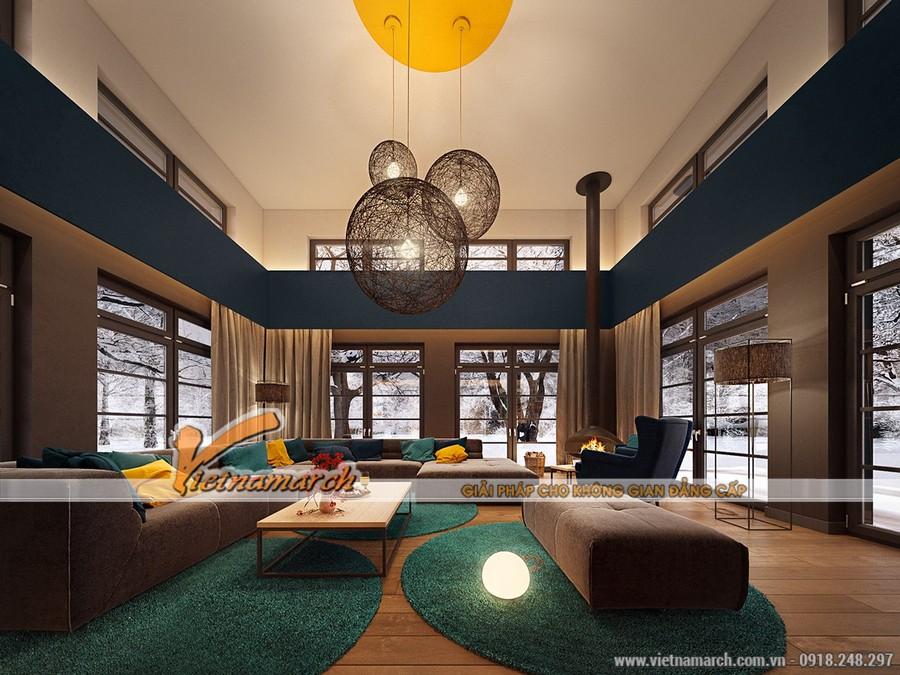 Nội thất phòng khách hiện đại có sự kết hợp nổi bật của màu xanh, vàng