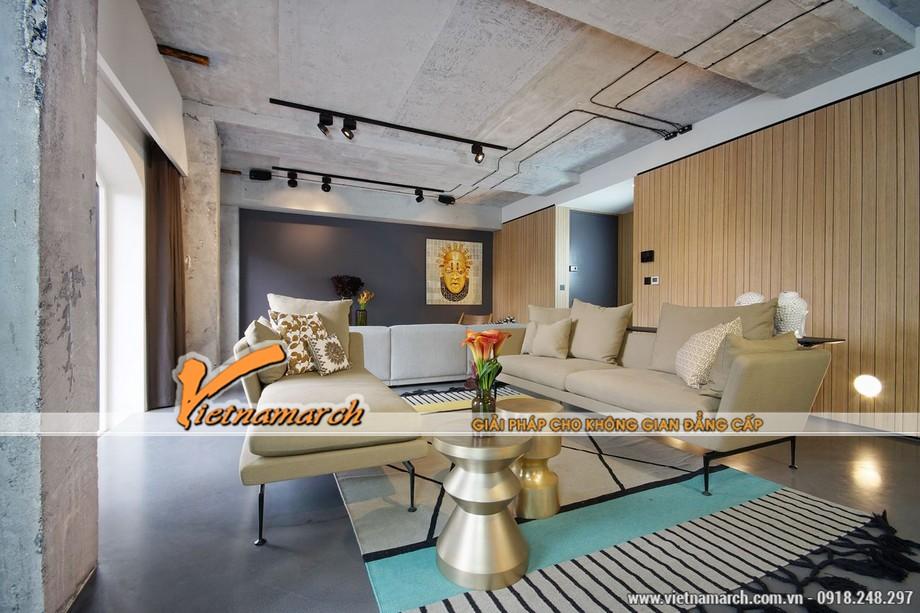Tường và trần nhà vẫn còn là bê tông thô đủ để làm đồ nội thất phòng khách nổi bật