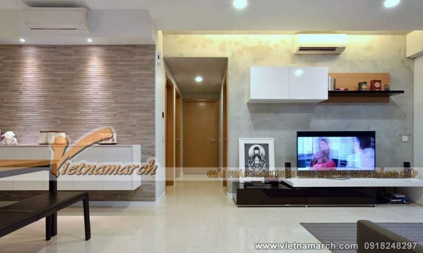 Lối đi lại thông thoáng ở chính giữa của căn nhà, và cũng khéo léo phân chia không gian phòng khách và nhà bếp