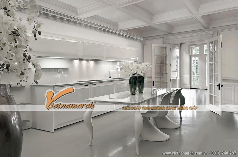 Màu sắc, bố cục và thiết kế chân ghế đường nét cong độc đáo là điểm nhấn của căn bếp này.