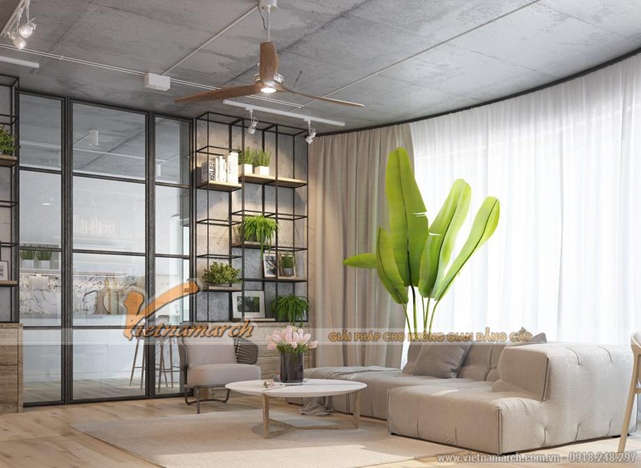 Phòng khách tự nhiên với trần bê tông và được bổ xung nhiều màu xanh từ cây cảnh