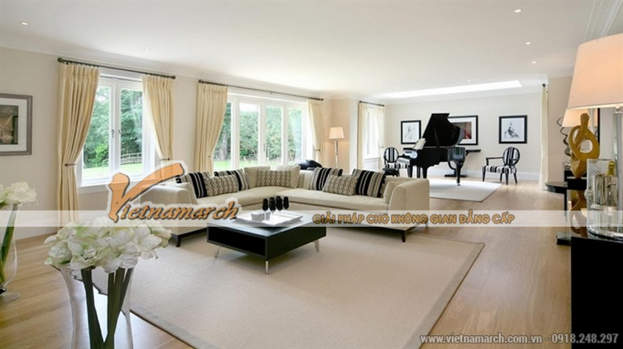 Sử dụng sàn gỗ, trần thạch cao tạo không gian rộng, thoáng cho phòng khách