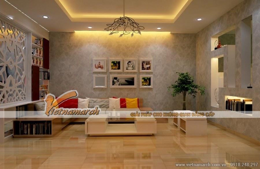 Mặt sàn sáng bóng cùng sofa gỗ tạo không gian sáng, thoáng cho căn phòng