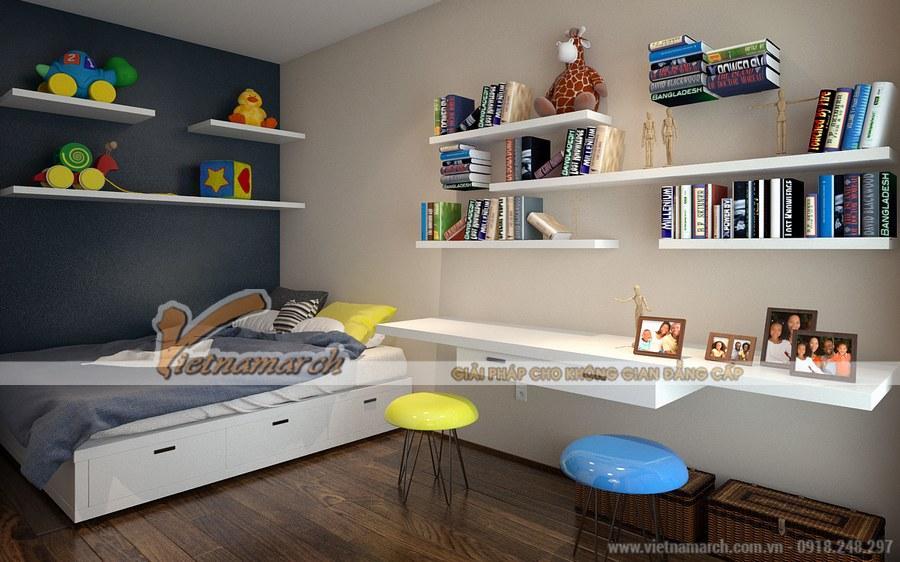 Gam màu trầm, trung tính chủ đạo cho căn phòng được nhấn nhá bởi sắc xanh, vàng của những chiếc ghế, gối hay các đồ chơi, bìa sách