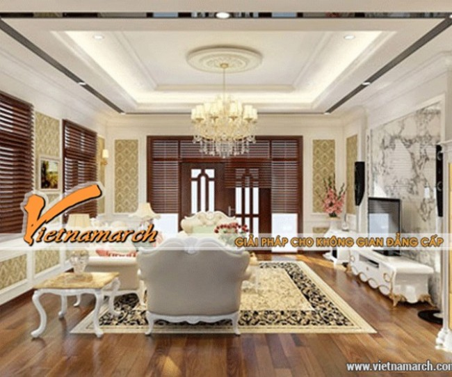 Với thiết kế trần thạch cao cùng bài trí nội thất mang lại không gian thanh lịch cho phòng khách chung cư Royal City
