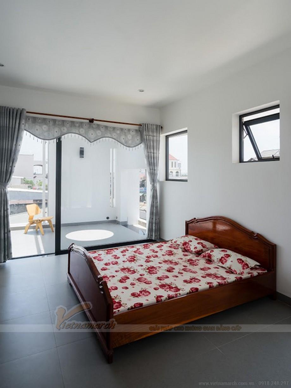 Phòng ngủ gọn gàng chan hòa ánh sáng
