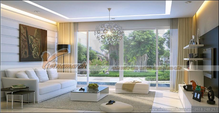 Phòng khách với nội thất hiện đại, không gian rộng, chan hòa ánh nắng nhờ hệ cửa kính lớn