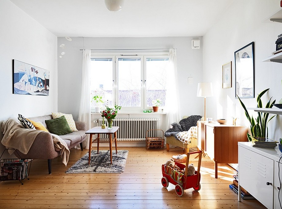 Rèm cửa nhẹ nhàng, họa tiết đơn giản là bí quyết giúp căn hộ rộng lớn.