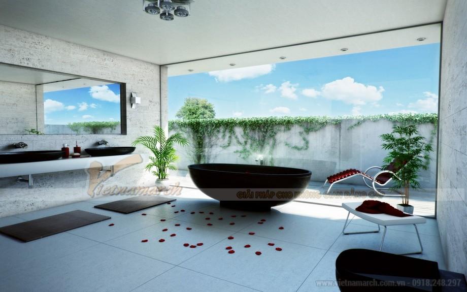 Phòng tắm được thiết kế độc lạ, mang nhiều không gian tự nhiên vào.