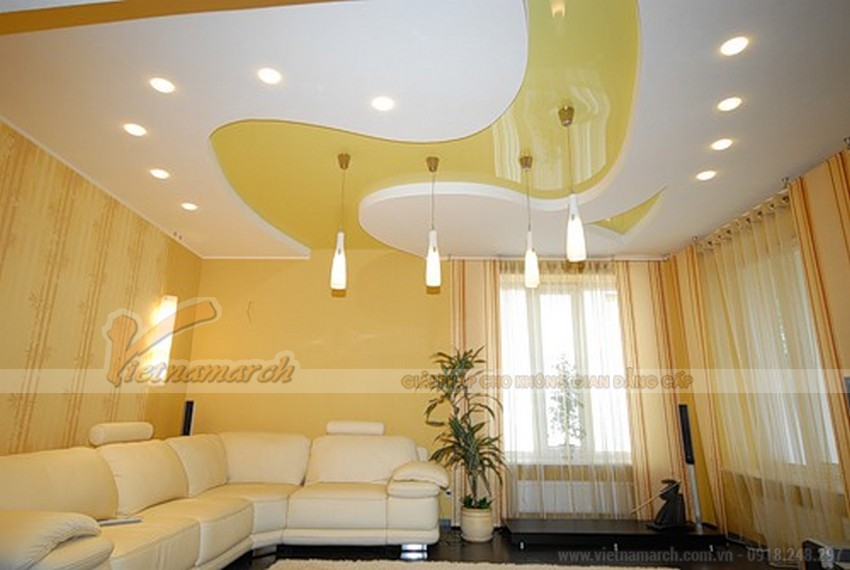 Phối màu vàng trắng trần nhà thạch cao phòng khách hiện đại