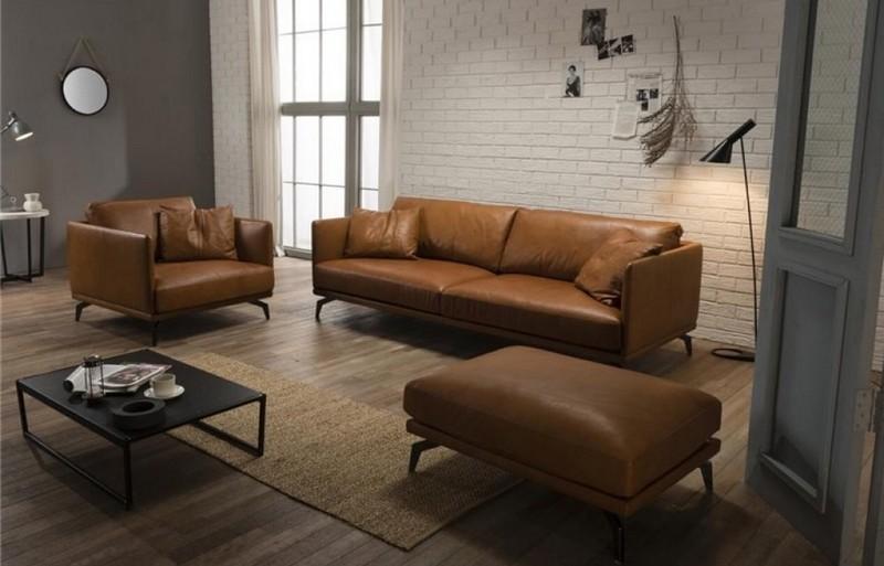 Mẫu ghế sofa văng da bò bày trí kèm đôn sofa để tăng thêm số lượng chỗ ngồi