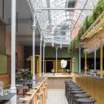 Thiết kế nội thất coworking space kết hợp khách sạn tại Anh phong cách hữu cơ kết hợp nét hoài cổ