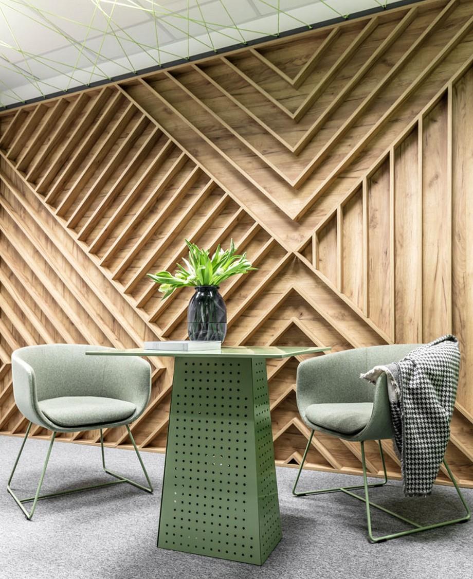 Thiết kế nội thất văn phòng với tấm ốp gỗ họa tiết xương cá và gam màu pastel ấn tượng