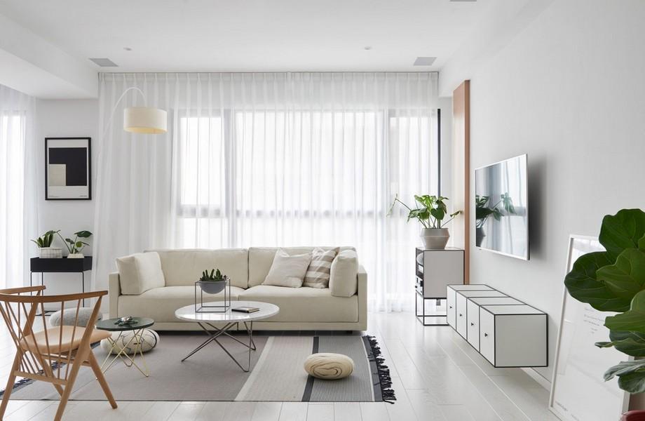Thiết kế chung cư 70m2 đẹp phong cách Scandinavian với chiếc sofa văng màu be, kệ tivi màu trắng có thiết kế thú vị