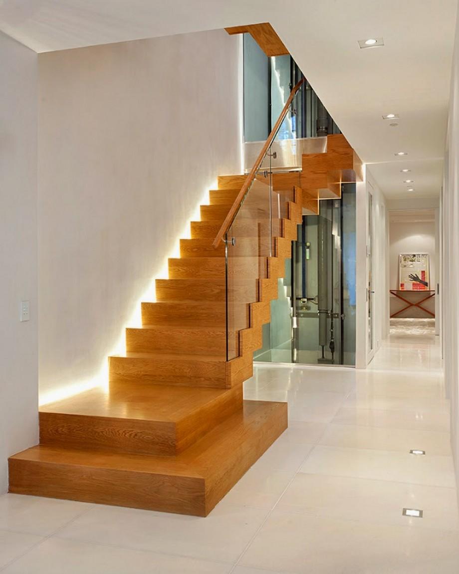 Thiết kế cầu thang đẹp cho biệt thự với chất liệu gỗ, lan can kính hiện đại