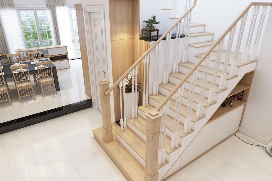Thiết kế cầu thang đẹp cho biệt thự hiện đại với chất liệu gỗ sồi, lan can mảnh mai sơn trắng trẻ trung