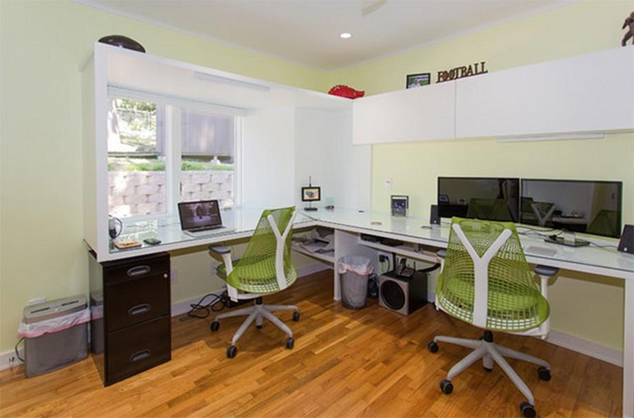 Thiết kế văn phòng siêu nhỏ phong cách hiện đại với 3 tông màu chủ đạo là trắng, đen và xanh lá