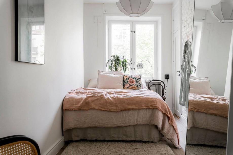 Giường ngủ bồng bềnh sang trọng với tông màu trung tính